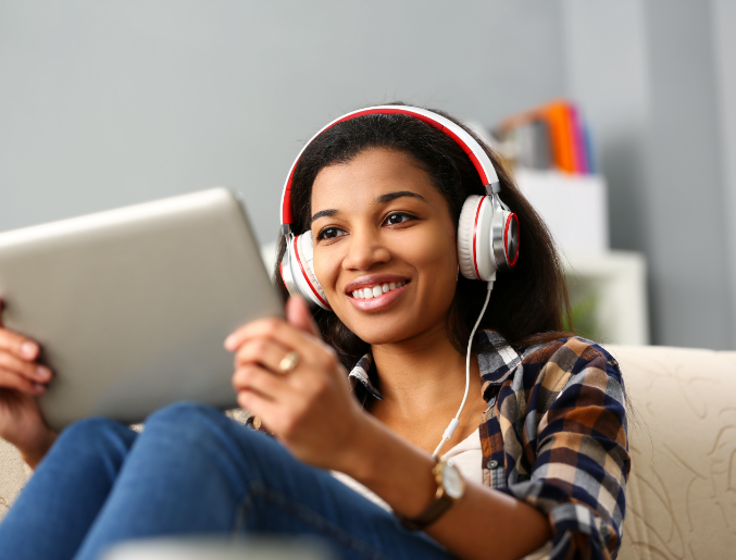 Picture of young female using an electronic tablet