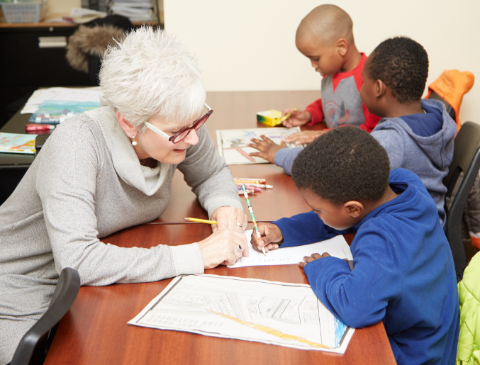 Picture of volunteer assisting a student at an Empowerment Squared homework circle