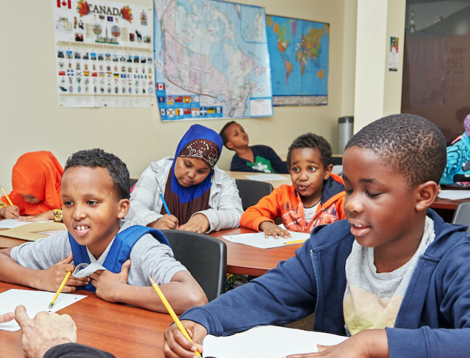 Picture of diverse young kids in a classroom