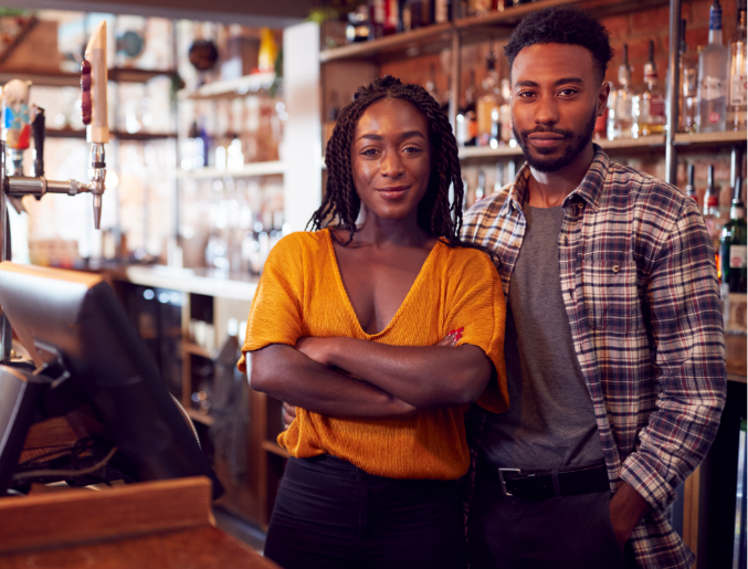 Picture of young, diverse couple operating a business