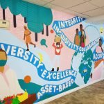 Local artist Kayla Whitney of Koe Design unveils stunning new mural at Empowerment Squared's downtown Hamilton location